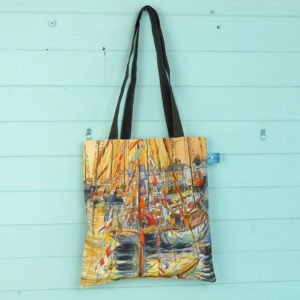 a tote bag printed with old gaffers sailing boats at sunset at Yarmouth on the isle of wight
