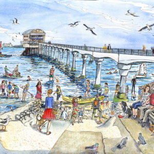 Bembridge lifeboat pier with children crabbing and paddle boarders on the Isle of Wight