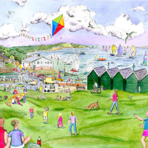 children flying a kite, people picnicking, beach huts and sailing boats at Gurnard green on the Isle of Wight