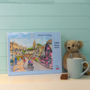 1000 piece jigsaw featuring thatched cottages and cyclists at Shanklin old village on Isle of Wight
