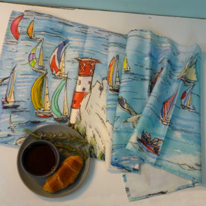 Yachts racing round the Needles on the Isle of Wight printed onto a table runner
